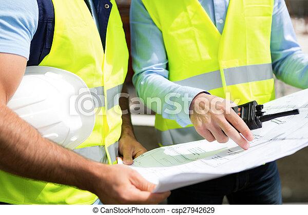 Details of blueprints on a construction site - csp27942629