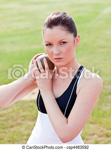 Determined female athlete ready to throw weight - csp4483592