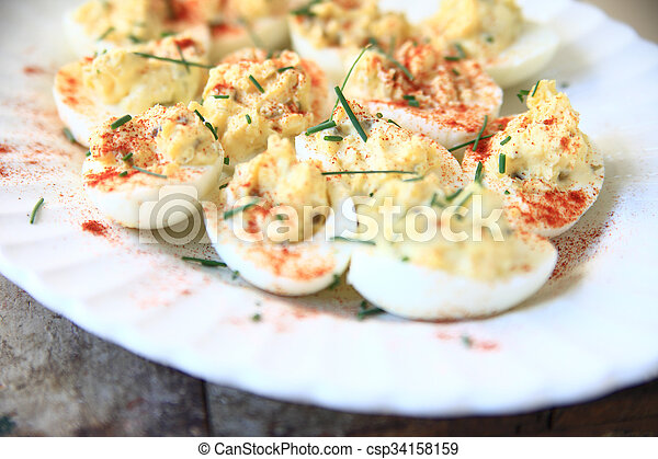 Deviled eggs with chives and paprik - csp34158159
