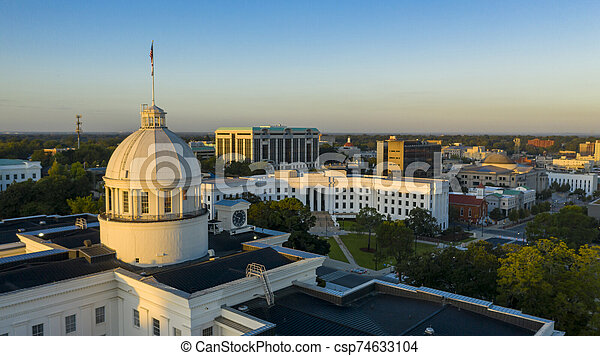 Dexter Avenue leads to the classic statehouse in downtown Montgomery Alabama - csp74633104