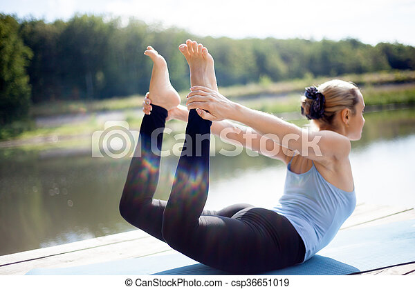 dhanurasana pose beautiful sporty fit blond young woman