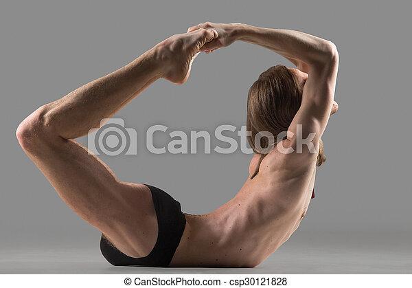 dhanurasana yoga pose sporty muscular young yogi man