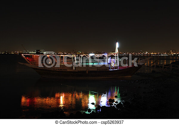 Dhow at night and reflection - csp5263937