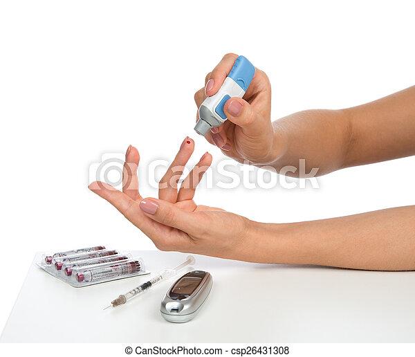 Diabetes concept finger prick for glucose level blood test - csp26431308