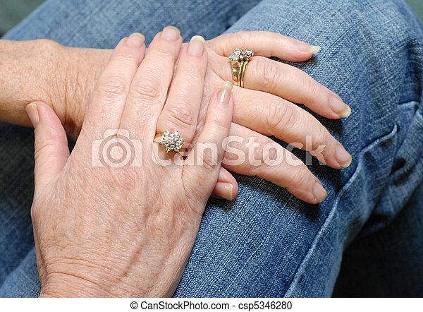 Diamond Rings On Married Seniors Hands