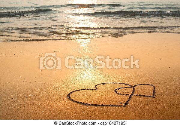 Dibujado arena playa mar corazones fotograf as de for Arena de playa precio