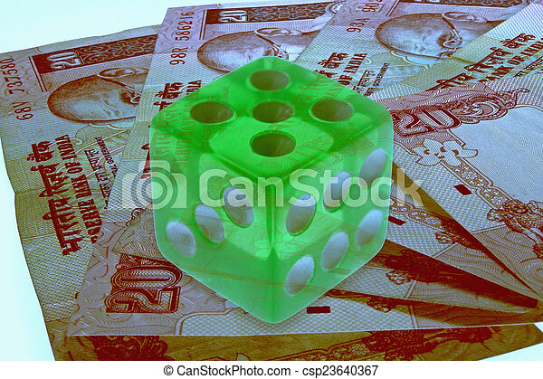 dice on money background, business concept - csp23640367