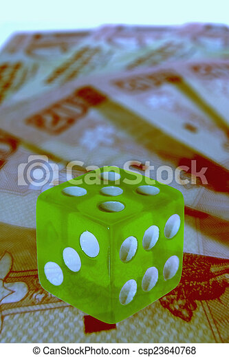dice on money background, business concept - csp23640768