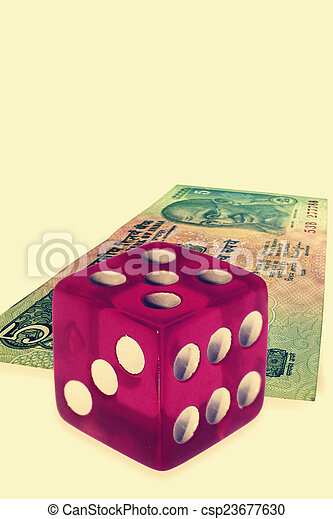 dice on money background, business concept - csp23677630