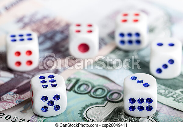 Dice on money background. concept of game - csp26049411