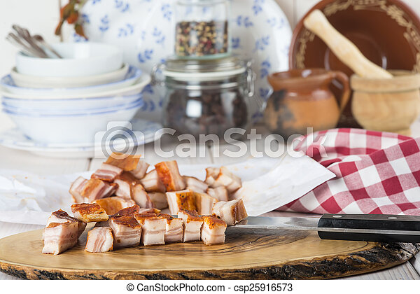 Diced bacon on the kitchen table - csp25916573