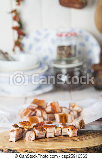 Diced bacon on the kitchen table - csp25916563