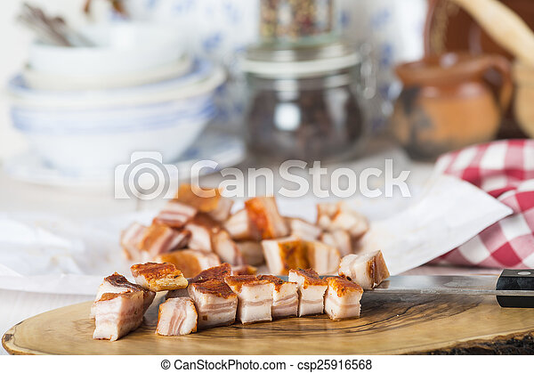 Diced bacon on the kitchen table - csp25916568