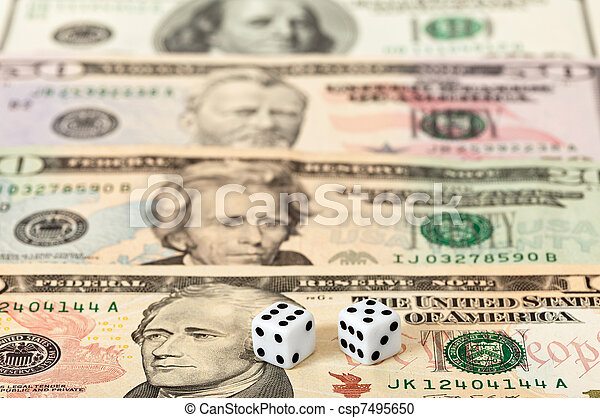 Dices on money background - business concept - csp7495650