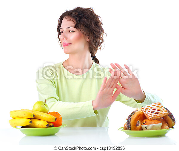 Diet. Beautiful Young Woman choosing between Fruits and Sweets  - csp13132836