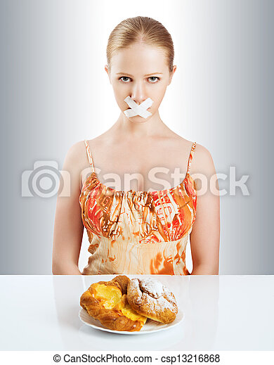 diet concept. woman mouth sealed with duct tape with buns - csp13216868