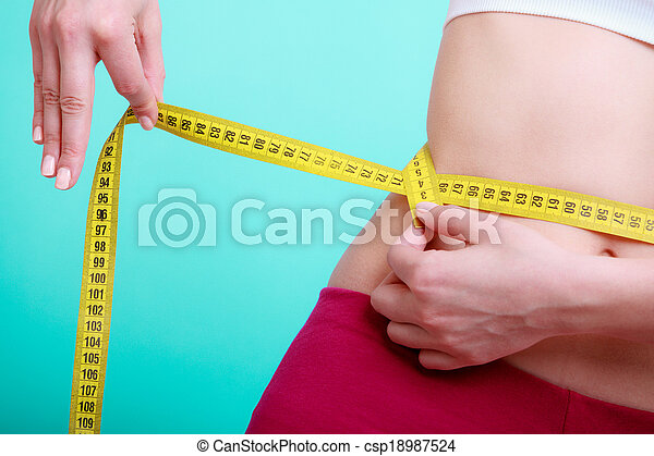 Diet. Fitness woman fit girl with measure tape measuring her waist - csp18987524