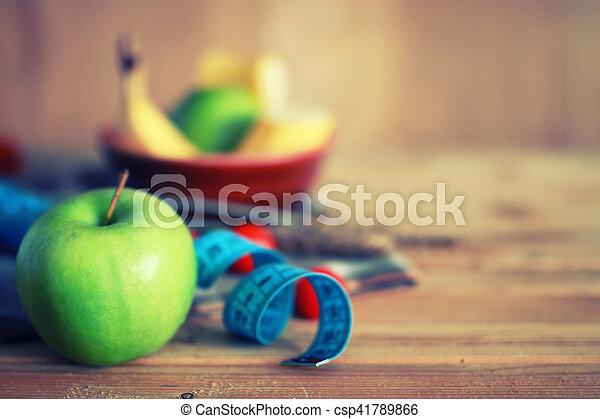 diet fruit apple centimeter wooden background - csp41789866