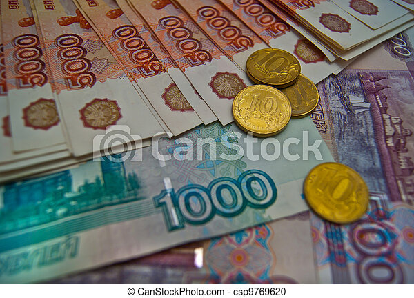 Different banknotes and coins background - csp9769620