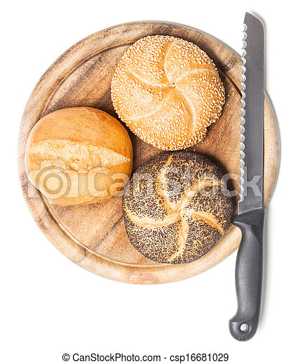 Different bread rolls on cutting board with knife - csp16681029