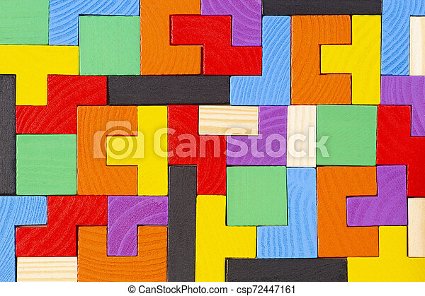 Different colorful shapes wooden blocks pattern background. Top view - csp72447161