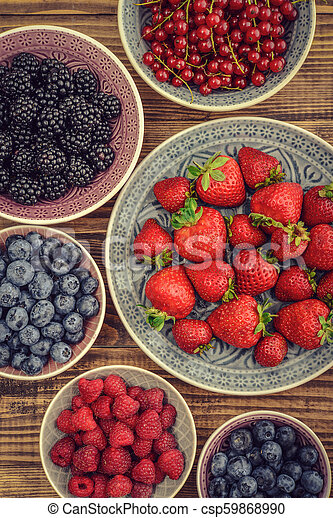 Different fresh summer berries - csp59868990