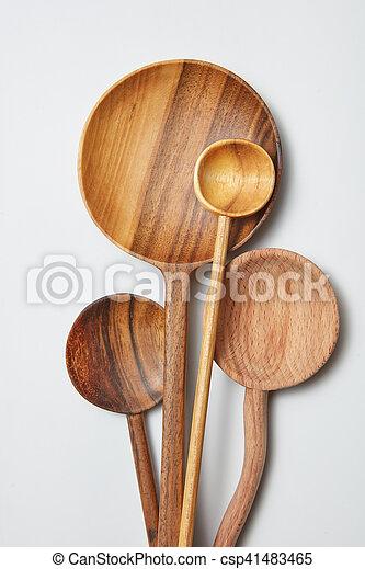 different kitchen wooden utensils on a white background - csp41483465
