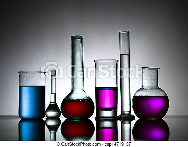 different lab bottles filled with colored substances - csp14719137