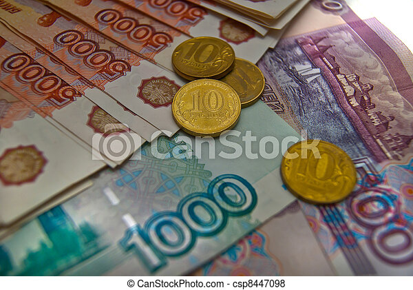 Different Russian banknotes and coins background - csp8447098