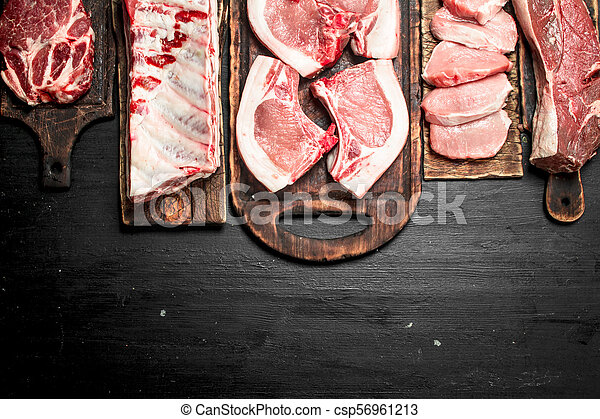 Different types of raw pork meat and beef. - csp56961213