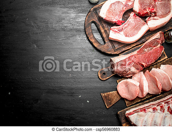 Different types of raw pork meat and beef. - csp56960883