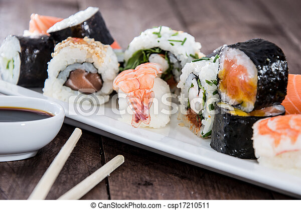Different types of Sushi on a plate - csp17210511