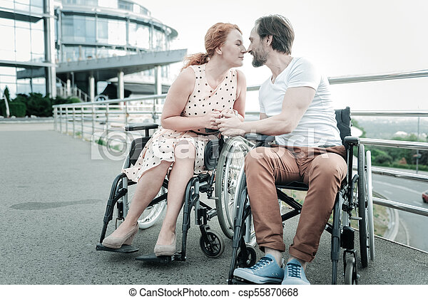 Differently abled couple spending time with pleasure - csp55870668