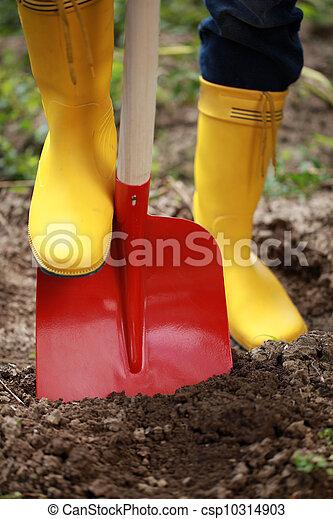 Digging soil with a shovel - csp10314903