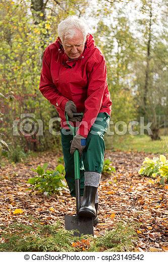 Digging the garden - csp23149542