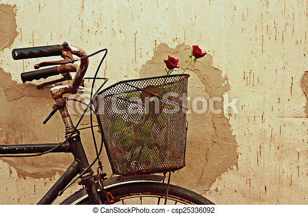 Digital painting of red roses in an old bicycle basket - csp25336092