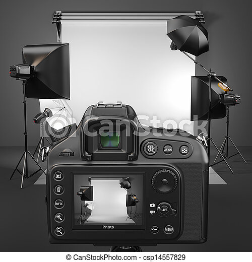 Digital photo camera in studio with softbox and flashes. - csp14557829