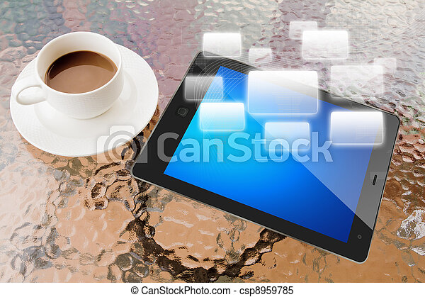 Digital tablet and cup of coffee on work table - csp8959785