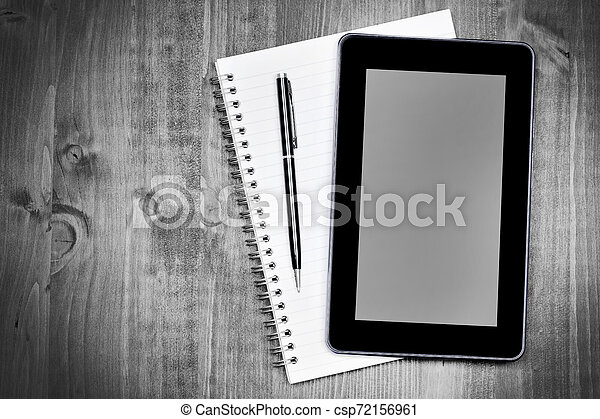 Digital tablet pc and notebook on desk - csp72156961