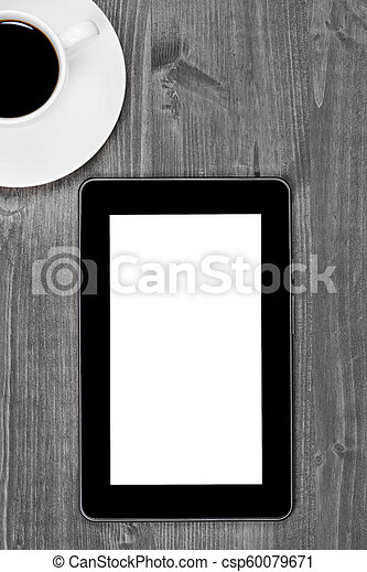 Digital tablet pc with coffee cup on desk - csp60079671