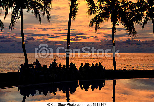 Diner on the beach at sunset - csp4812167