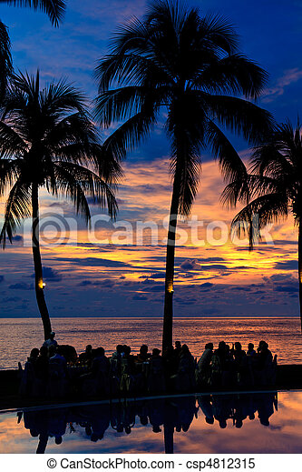 Diner on the beach at sunset - csp4812315