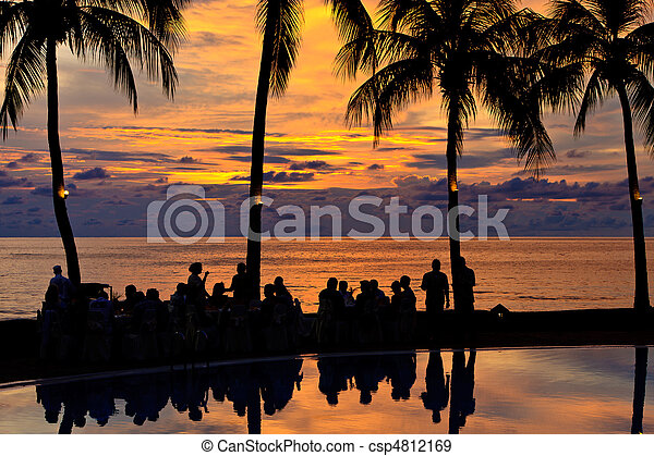 Diner on the beach at sunset - csp4812169