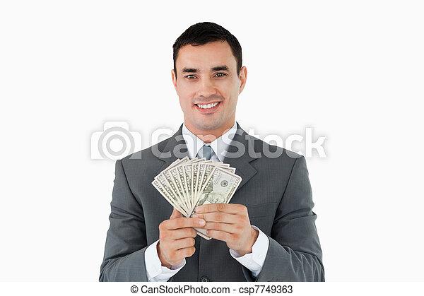 Hombre de negocios con dinero - csp7749363