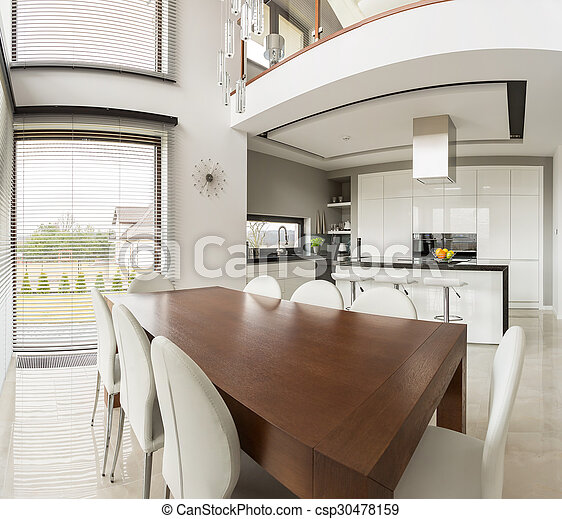Dining area and open kitchen - csp30478159
