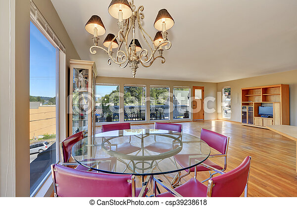 Dining Area With Round Glass Table And Red Chairs Spacious Empty Living Room With Hardwood Floor Northwest Usa Canstock