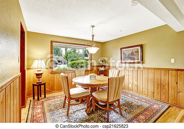 Dining room in log cabin house - csp21625823