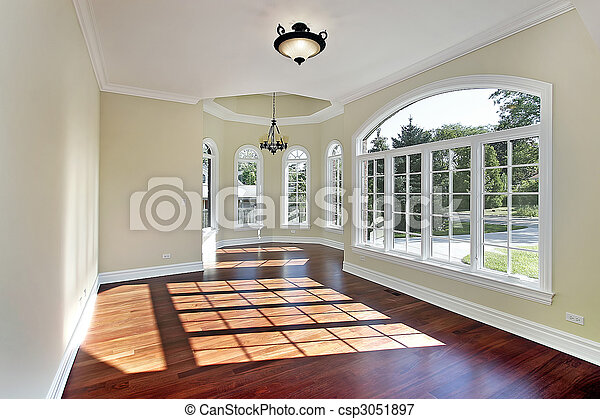 Dining room with cherry wood flooring - csp3051897