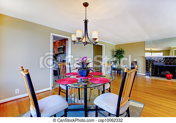 Dining room with round table and fireplace. - csp10062332