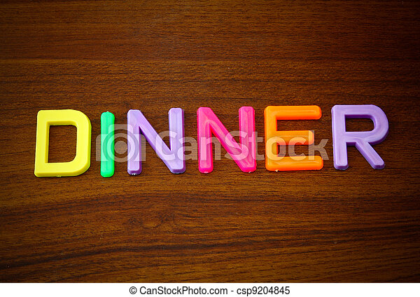 Dinner in colorful toy letters - csp9204845